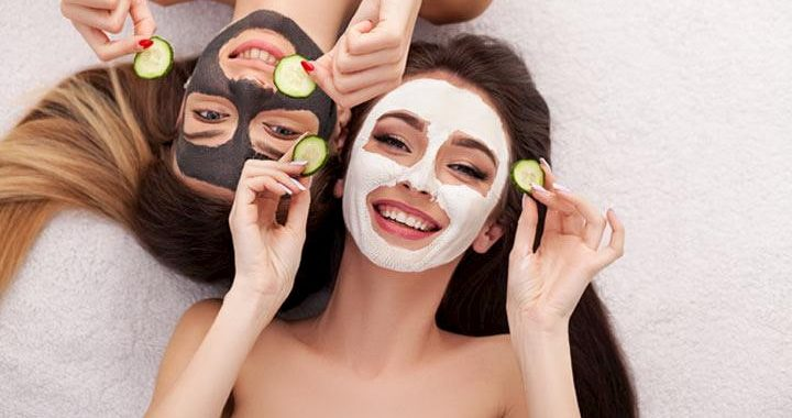 girls with face mask an cucumbers in their hands