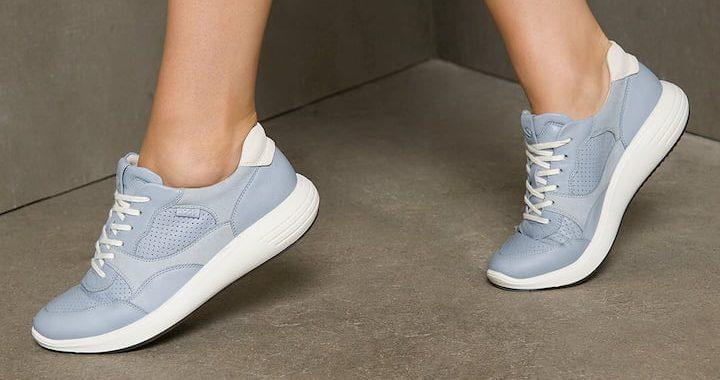 woman wearing blue ecco sneakers