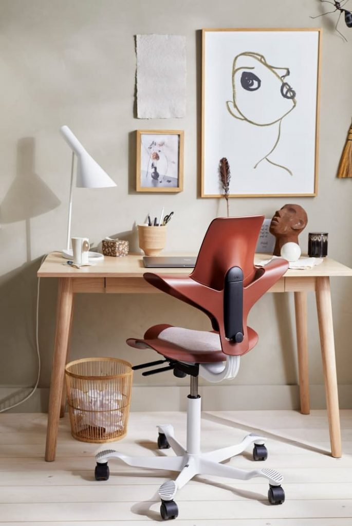 home office with modern saddle chair and desk