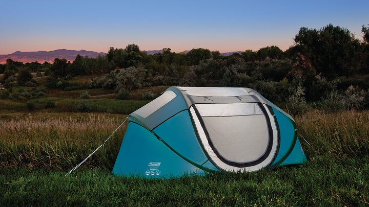 blue camping tent with nature background