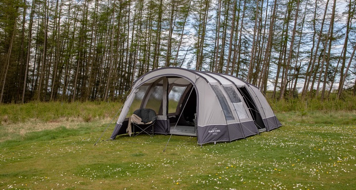 camping tunnel tent and nature background
