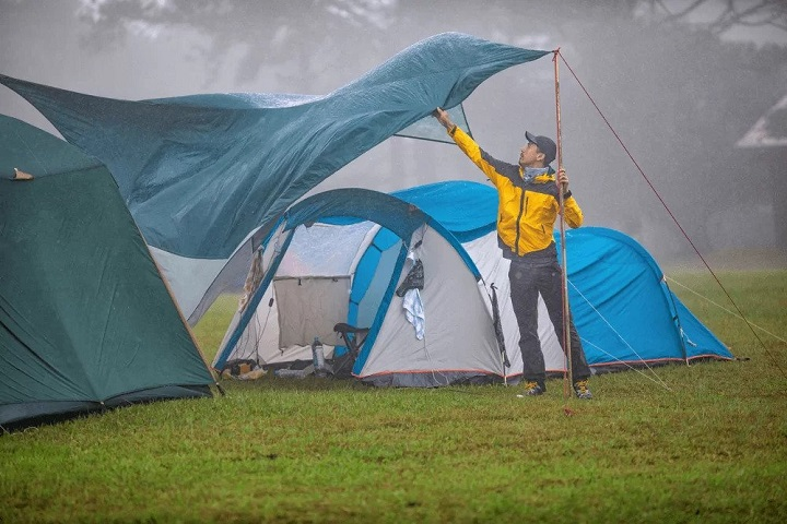person camping on rainy day