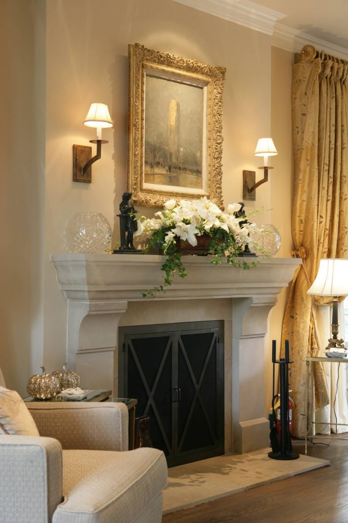 picture with two wall mount lights over an fireplace