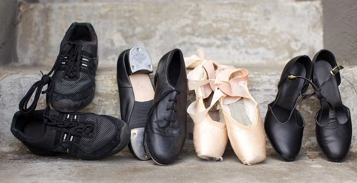 picture of different dancing shoes on a concrete